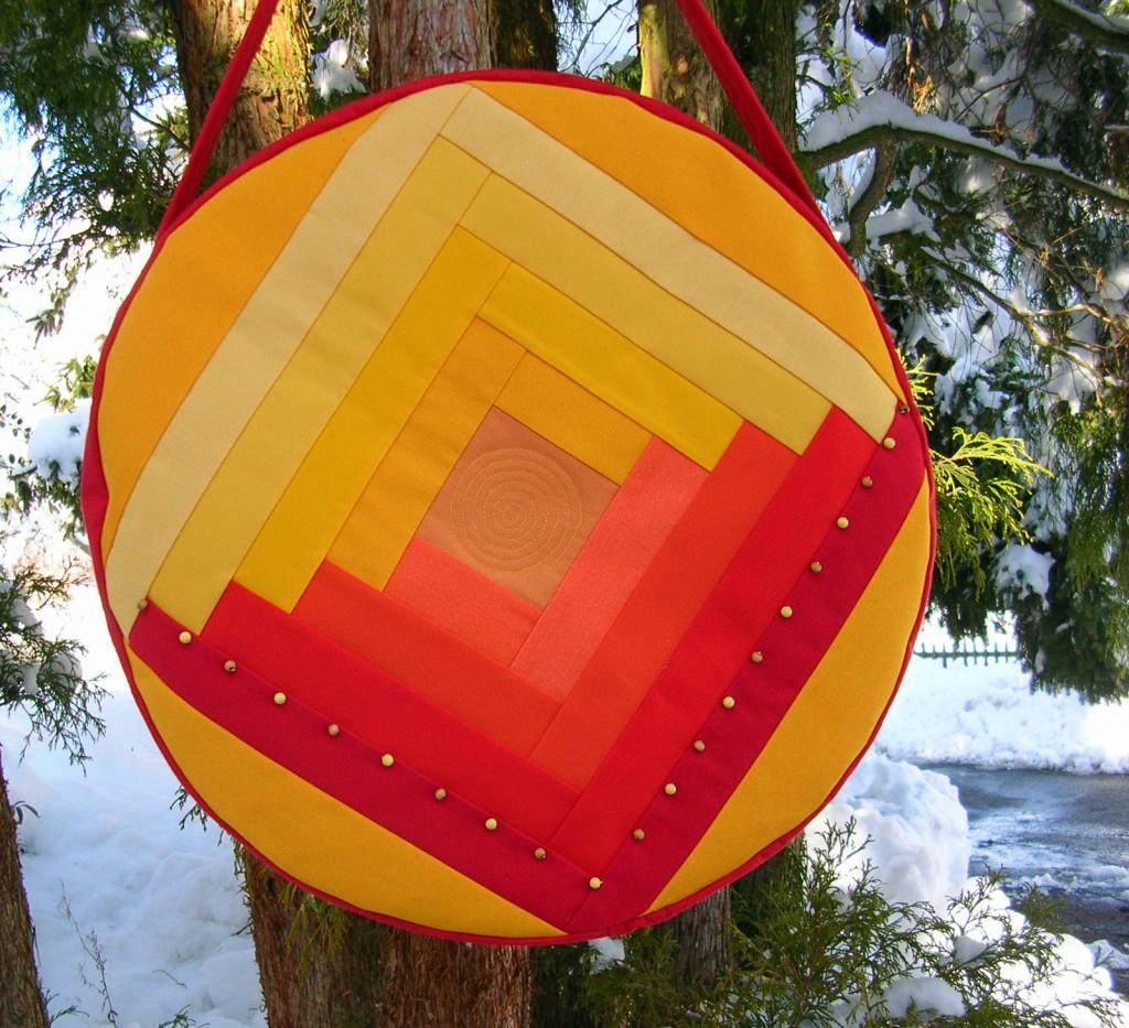 Trommeltasche mit Streifen in gelb und rot, mit Quiltspirale