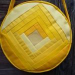 Trommeltasche mit Streifen in gelb und Quiltspirale